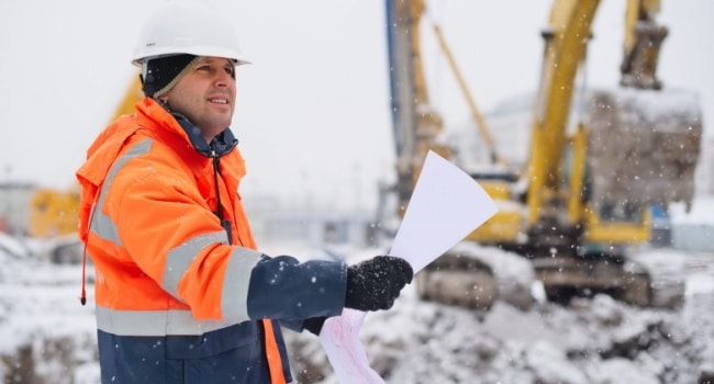 Man working in the snow during the winter